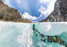 Female inside the crack in the ice glaciers Iceland. Wide-angle panorama Royalty Free Stock Photo