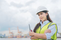 Female inspect container in port.  Royalty Free Stock Image