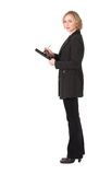 Female inspector #8. Full portrait of female inspector making notes Royalty Free Stock Image