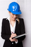 Female Inspector Checking Notes Royalty Free Stock Photo