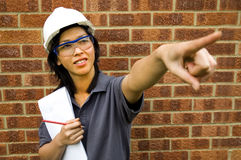 Female Inspector/Engineer. On site with Brick background Royalty Free Stock Photography