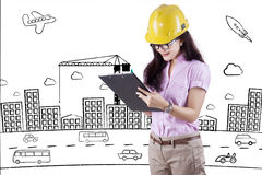 Female inspector with project design Stock Photo