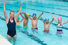 Female instructor with children enjoying in swimming pool Royalty Free Stock Photo