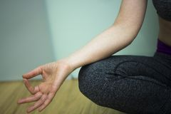Yoga teacher mudra asana. Female instructor yoga teacher teaching asana pose with mudra hand posture stock photography