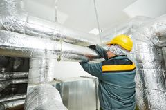 Female insulation worker Stock Image