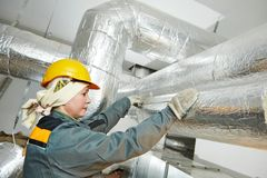 Female insulation worker Royalty Free Stock Image