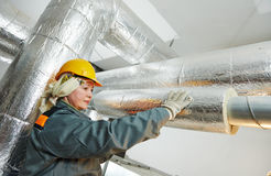 Female insulation worker Stock Photography