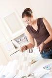 Female interior designer choosing color of tiles Stock Images