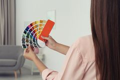 Female interior designer with color palette samples. Indoors royalty free stock photo