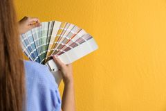 Female interior designer with palette samples on color background, closeup. Space for text stock photography