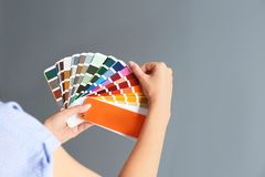 Female interior designer with palette samples on color background, closeup. Space for text stock images