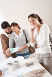 Female interior designer with two clients Stock Images