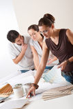 Female interior designer with two clients Stock Image