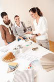 Female interior designer with two clients Royalty Free Stock Photography