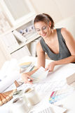 Female interior designer working with color swatch Royalty Free Stock Image