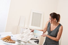 Female interior designer working at office Royalty Free Stock Images