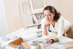 Female interior designer working at office Royalty Free Stock Photo