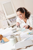 Female interior designer working at office Stock Photography
