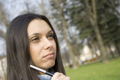 Female Is Thinking In The Park Stock Photography