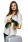 Female in jacket and gloves standing with travel bag Royalty Free Stock Image