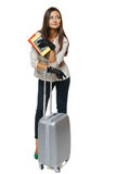 Female in jacket standing with travel bag Royalty Free Stock Image