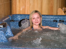 Female in the jacuzzi. The girl bathes in a hydromassage bath Stock Image
