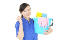 A female Janitorial cleaning service. The female worker who poses happy on white background Stock Photo