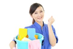 A female Janitorial cleaning service. The female worker who poses happy on white background Stock Photography