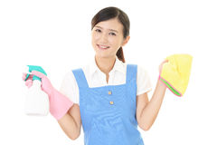 A female Janitorial cleaning service. The female worker who poses happy on white background Royalty Free Stock Images