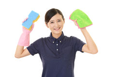 A female Janitorial cleaning service. The female worker who poses happy on white background Royalty Free Stock Photo