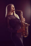 Female jazz musician performing on saxophone Royalty Free Stock Photography