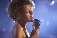 Female Jazz Singer On Stage. Closeup of a female jazz singer on stage Royalty Free Stock Photo