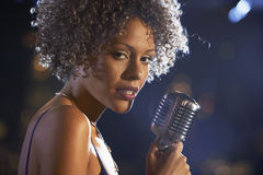Female Jazz Singer On Stage. Closeup of a female jazz singer on stage Stock Photography