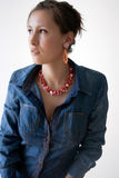Female in jeans and denim shirt Stock Images