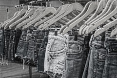 Female jeans Mono hangers street market Stock Photo
