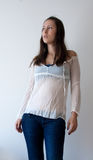 Female in jeans and romantic blouse Stock Images