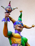 Female Jester. A colorful female jester statue holding a jester baton Royalty Free Stock Photos