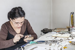 Female Jewelerer. Portrait of a female jeweler working at her workplace Stock Image