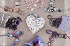 Female jewelry and decorative heart Royalty Free Stock Photography