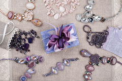Female jewelry and gift box on linen tablecloth Stock Photos