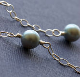 Female jewelry necklace pearls on colorful backgro stock photos