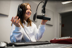 Female Jockey Communicating On Microphone In Radio Studio Stock Photography