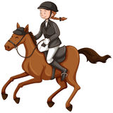 Female jockey doing equestrian Stock Image