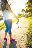Female jogger in a city park view from behind Royalty Free Stock Photos