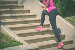 Female jogger climbing the steps stock photos