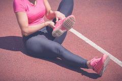 Twisted ankle while jogging royalty free stock images