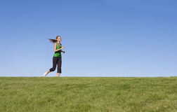Female Jogger on the horizon Royalty Free Stock Image