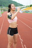 Female jogger hydrating on a running track. Female jogger hydrating on the running track stock photos