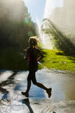 Female jogger with lens flares Royalty Free Stock Photos