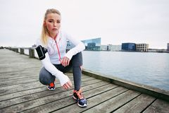 Female jogger outdoors looking confident Stock Photos